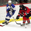 Marblehead's Chris McLeod and Scituate's battle it out during the Eastern Mass Division 3 final at Harvard's Bright aRena Wednesday March 10, 2010. Item Photo/ Reba M. Saldanha