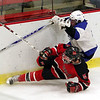 Marblehead's Alex Whitmore and Scituate's Mike Cook battle it out during the Eastern Mass Division 3 final at Harvard's Bright aRena Wednesday March 10, 2010. Item Photo/ Reba M. Saldanha