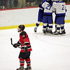 Marblehead's Hunter Graves skates away as Scituate celebrates their first period goal during the Eastern Mass Division 3 final at Harvard's Bright aRena Wednesday March 10, 2010. Item Photo/ Reba M. Saldanha