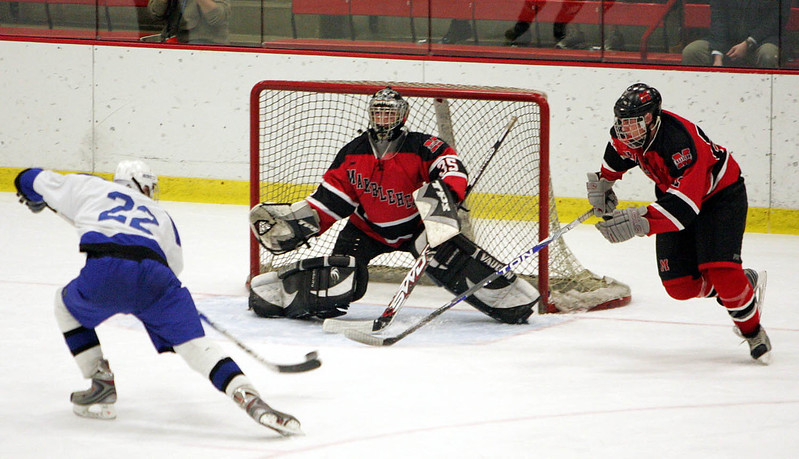 Marblehead's Tony Cuzner and Ben Kopman, left, try unsuccessfully to stop a first period goal by Scituate's Matt Mitchell during the Eastern Mass Division 3 final at Harvard's Bright aRena Wednesday March 10, 2010. Item Photo/ Reba M. Saldanha
