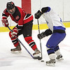 Marblehead's Jay King and Scituate's Pat Folaro battle it out during the Eastern Mass Division 3 final at Harvard's Bright aRena Wednesday March 10, 2010. Item Photo/ Reba M. Saldanha