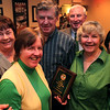 Friendly Knights of St. Patrick 2010 Irish Man of the Year Richard McGuiness, center, poses with siblings (from left) Mary Ellen Connelly, Patty Henkenmeier, James McGuinness, Judy Olson and Kathy Wilkins at 63rd Annual Scholarship dinner at Old Tyme Italian Cuisine in Lynn Thursday evening. Dr. James L. McGuinness, father to the clan and the 1978 award recipient, was one of the founders of the Friendly Knights of Saint Patrick. <br /> <br /> Item Photo/ Reba M. Saldanha