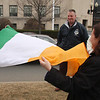 Raising of the Irish flag in City Hall Square,Lynn. Kick Wall, left, President of Hibernian Hall Div. 10 in Lynn, Mike Ready, President of building Corp, Mary Chalmers, Ladies LO.A.O.H. and Mayor Judith Kennedy unfold the Irish flag prior to rising it in City Hall Square.