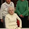 Kay Lundergan, sitting, made Guiness cup cakes with Baileys frosting from a recipe she found in a Chris Stevens column in the Item.  Standing behind her are Theresa Gately, left, and Ann Travers.