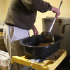 Paul Lundergan removing vegetables from the 50 gallon pot.