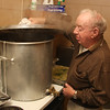 Seventeen years ago Paul Lundergan started cooking a corn beef dinner for patrons at the Hibernian Hall in Lynn. Today that dinner feeds 150 people and requires 100 pounds of corn beef, 50 pounds of carrots, 50 pounds of potatoes, and two pots, a 30 gallon and a 50 gallon. Here, Paul is checking the vegetables in the 30 gallon pot.