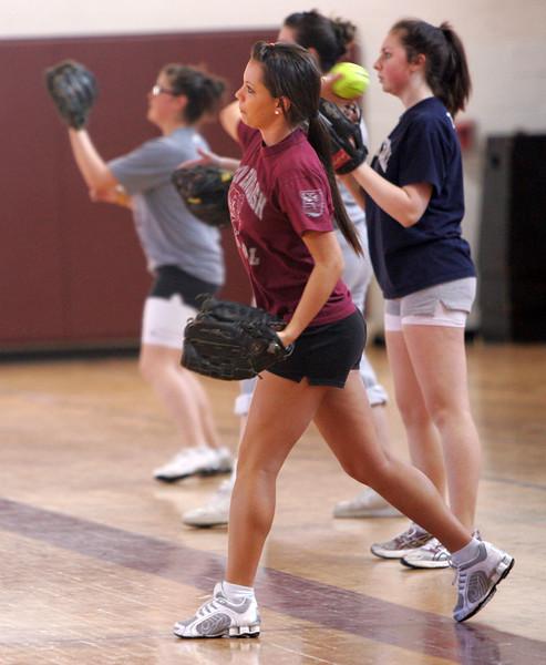 Valerie Fiacaprili thros the ball during the Lynn English softball practice Tuesday March 16, 2010. Item Photo/ Reba M. Saldanha
