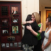 Debbie, McManus hugs her daughter Yiyi after the unveiling. Daughter Susanna is off to the right.