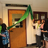 The unveiling of the guidance office. On left are: Kay Marni, and John McManus. On right are: Kay, Laura Christensen, Yiyi and Susanna McManus.