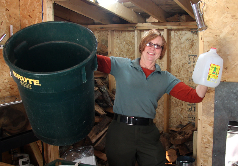 Lynn Hildenbrand says it all in the sugar shack at Breadheart Reservation.You need one barrel of sap to get one gallon plastic bottle of syrup.