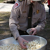 Mike Nelson prepares pop corn with maple syrup at the Breakheart Reservation Maple sugaring program.