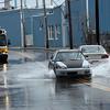 Cars navigate flood waters on Summer Street in Lynn Monday March 1, 2010. Item Photo/ Reba M. Saldanha