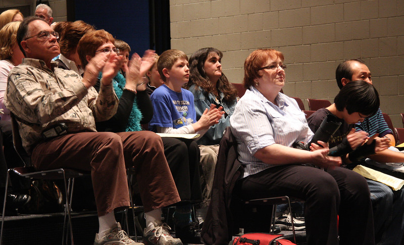 The audience clapping after a round was concluded.