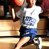 Melvin Nieves from Ford School moves the ball down court.