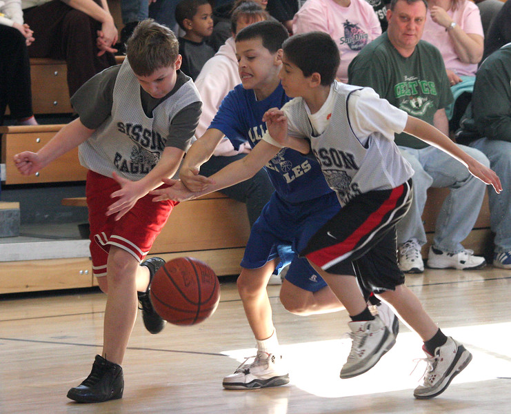 Alex Bogovac, left, George Dimas, and Tyler Drillis scramble to the ball.