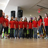The Veteran's Middle School Select Chorus under the direction of Bob Tirelli sang songs at noon.