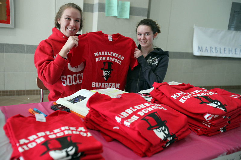 Seniors Ali Bishop, right, and Emma Crowley promote the National Honors Society during the Marblehead Home and Garden Show at Marblehead High School Sunday march 21, 2010. Item Photo/ Reba M. Saldanha