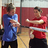 Saugus varsity softball coach Bobbie Finnochio, right, instructs player Jackie Doherty during indoor practice Tuesday March 23, 2010. Item Photo/ Reba M. Saldanha