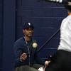 Coach Yuri Sanchez tosses a ball for Michael Aybar during indoor practice at Tech gym Tuesday March 23, 2010. Item Photo/ Reba M. Saldanha