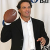Doug Flute was handing out awards in the form of footballs at the Eastern Bank in Lynn today.