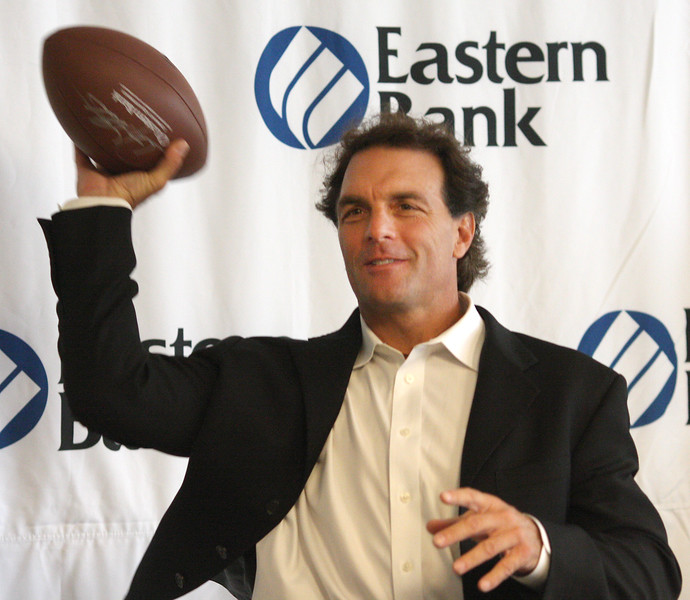 Doug Flute was on hand at Eastern Bank on Market Street in Lynn today  throwing some footballs out as awards to deserving recipients.