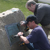 David DeFilippo and Charlie Sullivan begin to restore the Corporal Richard Davis plaque in Nahant.