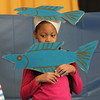 Students from the Washington School in Lynn preformed seven plays based on seven books by Erick Carle. Alejandra Pena as a fish in the performance of the book  A House for a Hermit Crab.