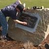 David DeFilippo restoring the Cpl Richard Davis plaque in Nahant.