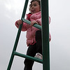 Maggie Lopez, 3, climbs at the Clarke School playground in Swampscott Thursday march 25, 2010. Item Photo/ Reba M. Saldanha