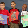Students from the Washington School in Lynn did seven plays based on seven  books written by Eric Carle.These three students from left to right: Elijah Pascal, Noel Hernandez and Hafeez Liad,  preforming the book From Head to Toe.