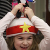 Students at the Oaklandvale School in Saugus celebrated the 106th birthday of Dr. Seuss today with green eggs and ham plus readings. Hailey Murphy interrupts her breakfast of green eggs and ham to adjust the cat on her hat.