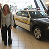 From left to right. Patrolman Tom Gaeta, police chief Domenic DiMella, and Susan Yee, manager of the Square One Mall with the new police car.