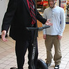 Craig Vezina, the head of security at the Square One Mall in Saugusand a Segway instructor, gives Mike Supino instruction on how to ride a Segway.
