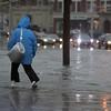 A pedestrian navigates flood waters in Peabody Square Tuesday March 30, 2010. Item Photo/ Reba M. Saldanha