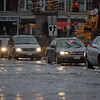 Cars make their way through flood waters in Peabody Square Tuesday March 30, 2010. Item Photo/ Reba M. Saldanha