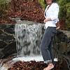 Lynne Feliz next to the new water fall in her back yard at 36 Linton Street in Lynn.