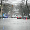 Cars stuck in flood waters in Peabody Square Tuesday March 30, 2010. Item Photo/ Reba M. Saldanha