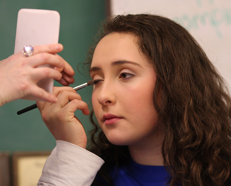 Career Day was held at the Belmonte Schoo in Saugus today. One of the speakers was Clarice McDonald from Mary Kay, and her talk included demonstrations. Here, Saugus students Sofia Raziq implements some of Clarice McDonald's tips.