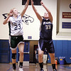 St. Mary's Molly Carey and Pentucket's Holly Jakobsons during the MIAA Div 3 north semi-final at St. John's Prep Wednesday March 3, 2010. Item Photo/ Reba M. Saldanha
