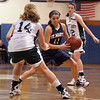 St. Mary's Kirsten Ferrari and Pentucket's Nicole Viselli, left, and Erin McNamara during the MIAA Div 3 north semi-final at St. John's Prep Wednesday March 3, 2010. Item Photo/ Reba M. Saldanha