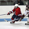 Lynn Jets Demetruis Polk and Concord-Carlisle's Jamie Sundquist in the Division 3 North semifinal at the Chelmsford Arena Thursday March 4, 2010. Item Photo/ Reba M. Saldanha