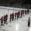Lynn Jets raise their sticks during the national anthum before the Division 3 North semifinal at the Chelmsford Arena Thursday March 4, 2010. Item Photo/ Reba M. Saldanha