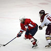 Lynn Jets Demetrius Polk and Concord-Carlisle's Justin Harris in the Division 3 North semifinal at the Chelmsford Arena Thursday March 4, 2010. Item Photo/ Reba M. Saldanha