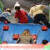 Winter Fest Johnson School Nahant. Kids scale the ropes in order to slide down the slide.