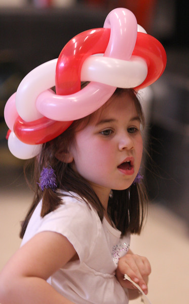 Winter Fest, Johnson School, Nahant, Saturday. Balloon hats made by Ju-Ju the Jollyologist were all the rage as demonstrated by Maura Cronin.