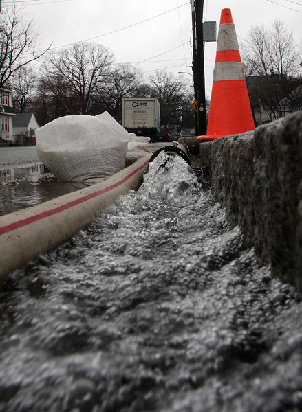Flooding day two. Water being pumped onto Lynnfield Street in Lynn.