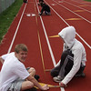Members of the Saugus varsity track team Jake Roy, left, and David Cacciola were on hand Saturday morning to correct the marking on the track located behind the Belmonte School in Saugus.