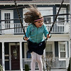 Samantha Andrews, 5, swings at the Clarke School playground in Swampscott Monday April 12, 2010. Item Photo/ Reba M. Saldanha