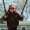 Gemma Gibeault, 5, swings at the Clarke School playground in Swampscott Monday April 12, 2010. Item Photo/ Reba M. Saldanha