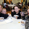 (from left) Chrissy ,Bryan, and JAckie Borrelli and Asia Curtis enjoy ice cream at the Lynn YMCA Family FUn night Monday April 12, 2010. Item Photo/ Reba M. Saldanha